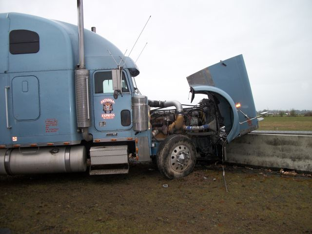 Freightliner crashed into concrete divider