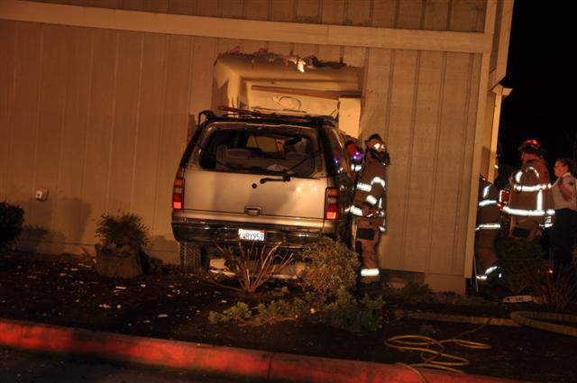 SUV crash into apartment