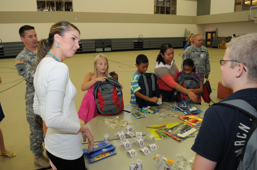 Nichole Mead, Miss Oregon 2012, speaks to children of Oregon National Guard members during Operation Homefront&#039;s Back to School Brigade event at Camp Withycombe in Clackamas, Ore., Aug. 10. The event, organized by the Oregon Chapter of Operation Homefront, gave school supplies and backpacks to children of Oregon National Guard members at no cost. Mead helped participants pick out school supplies and backpacks donated by Dollar Tree. (Oregon National Guard photo by Master Sgt. Nick Choy, Oregon Military Department Public Affairs).