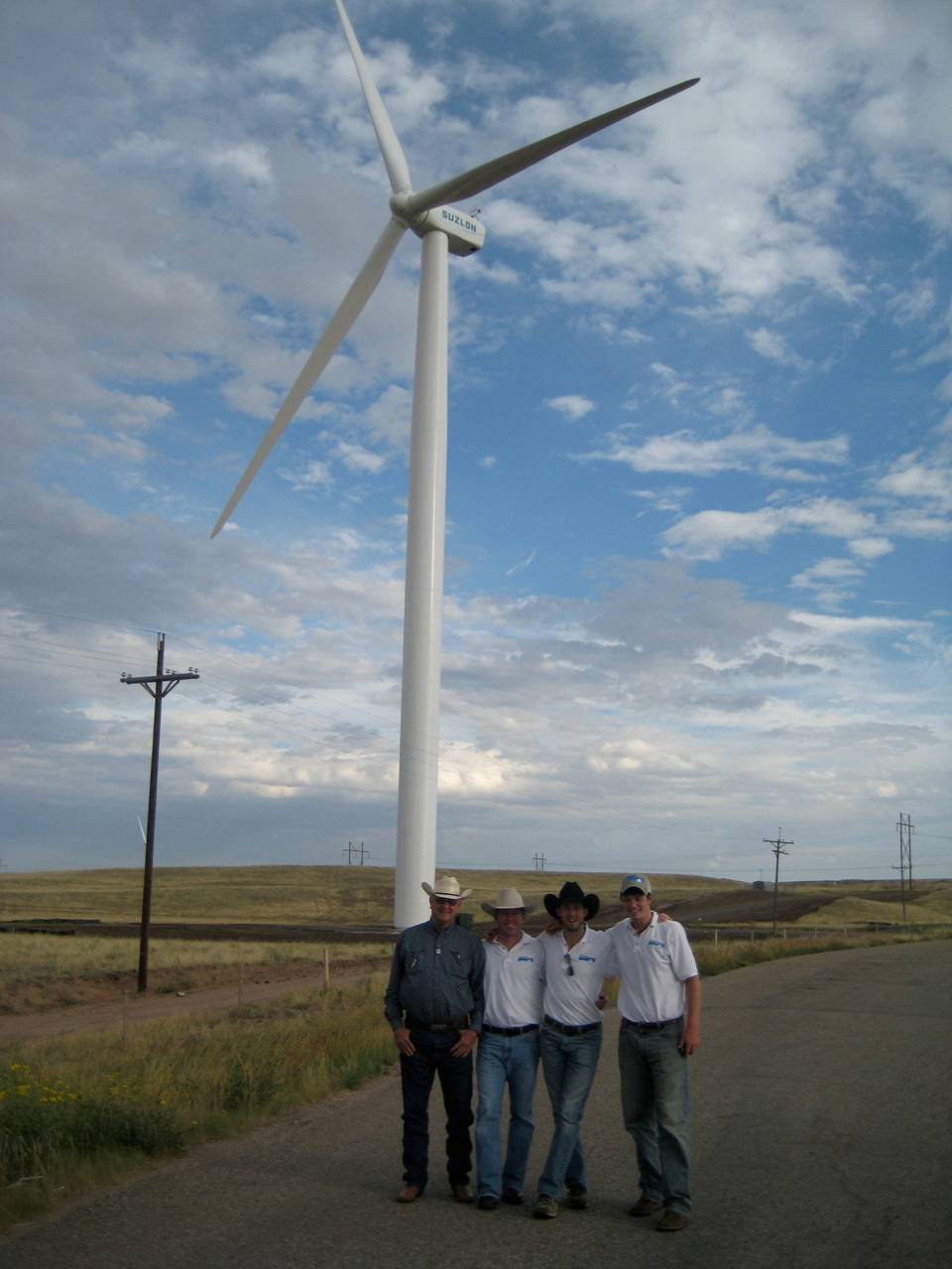 Nate Sandvig (2nd from left) and his project team at a windfarm site. Courtesy of Sandvig.