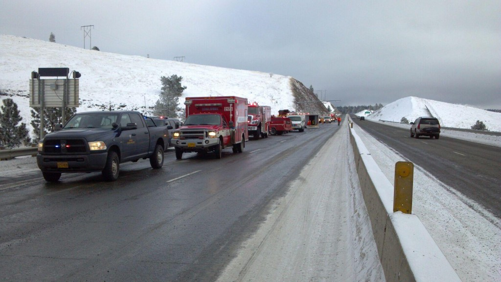 A photograph taken from the roadway showing emergency responding personnel at scene