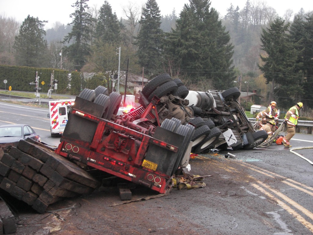 Crash: semi truck carrying a full load of used rail road ties sustained