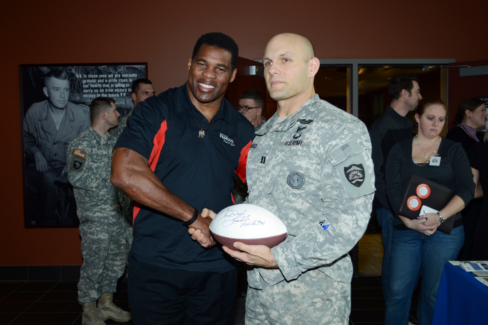 Herschel Walker, Heisman trophy winner and former NFL player, shakes hands with Oregon Army National Guard Captain Vincent Habeck at the 41 Infantry Division Armed Forces Reserve Center at Camp Withycombe in Clackamas, Ore., Feb. 6. Walker spoke to service members, veterans, and their families about his personal experiences with mental illness and the importance of seeking treatment. (Photo by Staff Sgt. April Davis, Oregon Military Department Public Affairs)