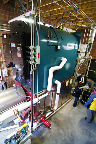 Estacada High School Biomass Boiler The woody biomass boiler at Estacada High School burns wood pellets, heats 120,000 square feet and saves the school over $11,000 per year in energy bills. Photo: Marcus Kauffman, Oregon Department of Forestry