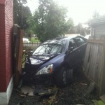 Car crashes into Aloha homes